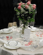 Den andra är dukad med en enkel vit servis med silverrand.